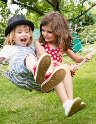 children playing in hammock