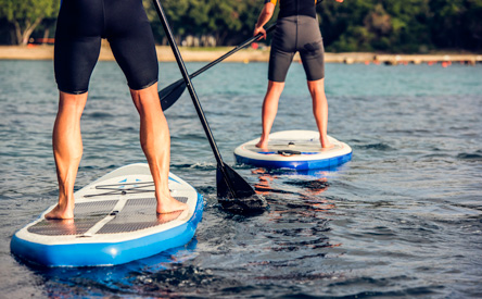 two people paddleboarding