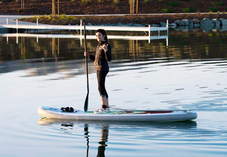 woman standing on paddleboard